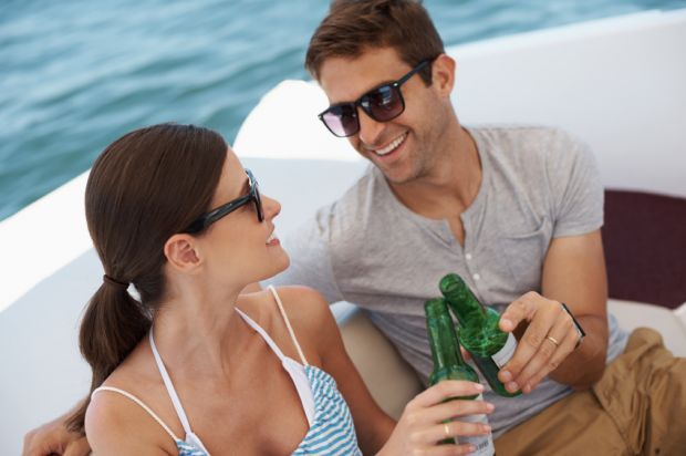 Couple drinking on boat