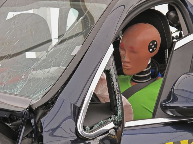 Crash Test Dummy in Car
