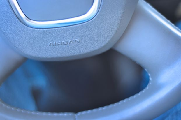Automobile airbag location on a steering wheel